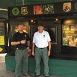 Andy Johnson and Bill Wiley with Firewise Display trailer, EDA 2017